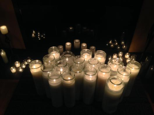 A candle for each person who participated in the HDS Winter Retreat. By Chris Alburger